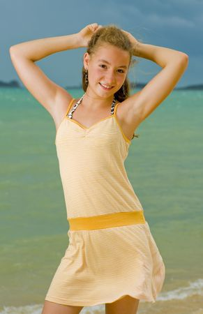 blond teenager model posing at the beach photo