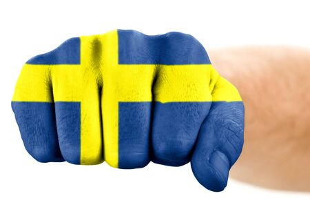 fist with swedish flag isolated on white photo