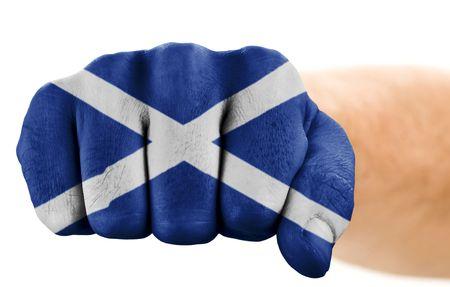 scotish: fist with schotish flag isolated on white