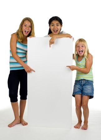 three young females point at something on a white board photo