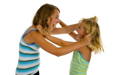 family fight: two sister girls having an argue, isolated on white
