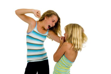 slap: two sister girls having a fight, isolated on white