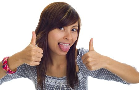 thai language: beautiful woman sticking tongue out and showing two thumbs up, isolated on white Stock Photo