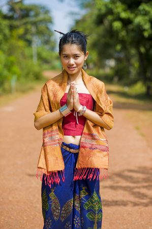 thai girl in traditional isaan style clothes with typical welcome expression Stock Photo - 5948041