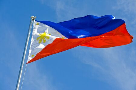philippine: philippine flag on a pole against blue sky