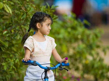 cute thai-indian girl sitting on her bike  photo