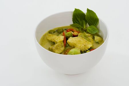 red  green: delicious thai food: green curry in a white bowl