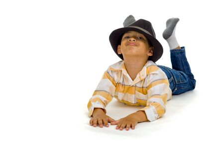thai boy: cute boy laying on the floor, isolated on white background