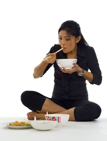 thai noodle: asian woman eating with chop sticks, isolated on white Stock Photo