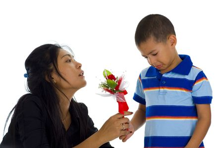 rueful: small boy apologising to his mother, isolated on white