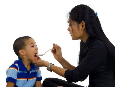 a mother feeding her son, isolated on white Zdjęcie Seryjne