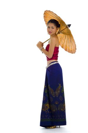 traditions: thai girl in traditional isaan style clothes with umbrella, isolated on white