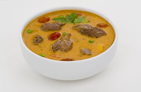 delicious thai food: red curry in a white bowl photo