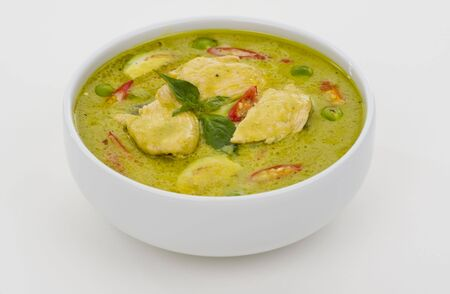 peas: delicious thai food: green curry in a white bowl