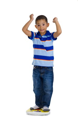 weighing: young boy happy with his weight, isolated on white