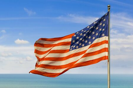us flag against horizon over water photo