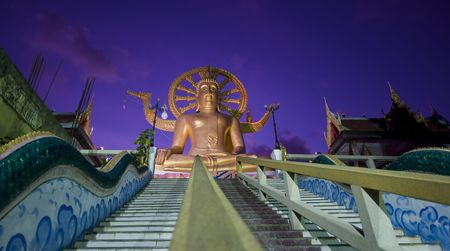 venerate: huge big buddha statue on koh samui in thailand right after sunset