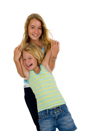 naughty girl: playful young naughty sisters having fun, isolated on white