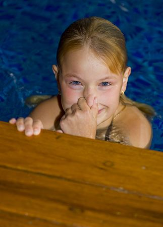 pool preteen: cute preteen having fun in a swimming pool Stock Photo