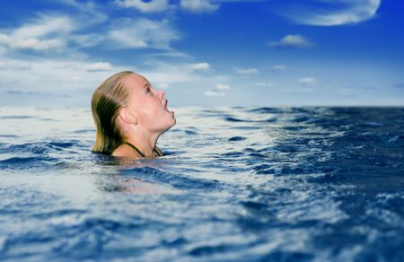 cute preteen in the ocean looking up with mouth wide open Stock Photo - 6682556