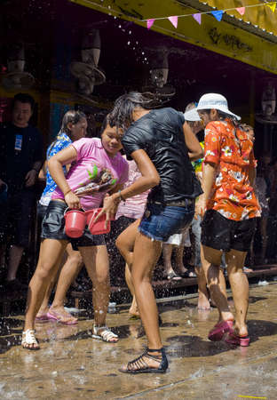 BANGKOK - APRIL 13 2010: Songkran (thai new year / water festival) is celebrated from april 13 to 15. people roam the streets and drench each other and passersby with water Stock Photo - 6896507