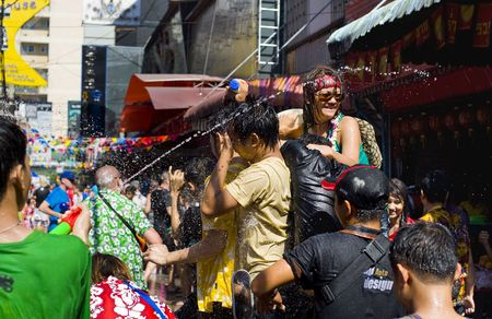 BANGKOK - APRIL 13: People celebrating Songkran (Thai new year / water festival) on the street and throwing water at each other on April 13, 2010 in Bangkok, Thailand. Stock Photo - 6896511