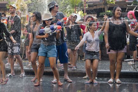 BANGKOK - APRIL 15: People celebrating Songkran (Thai new year  water festival) in the streets by dancing and shooting and throwing water at each other on April 15, 2010 in Bangkok, Thailand.