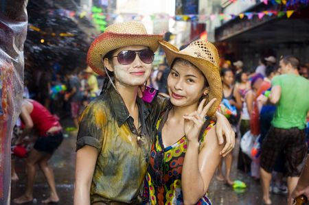 beauties: BANGKOK - APRIL 13: Two wet Thai beauties with faces full of powder celebrating Songkran (Thai new year  water festival) on April 13, 2010 in Bangkok, Thailand. Editorial