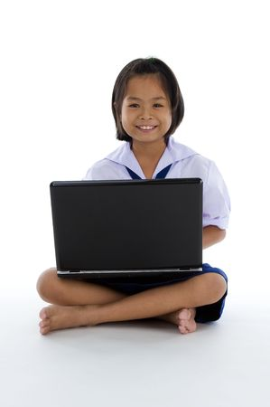 cute asian girl in school uniform with laptop isolated on white background photo