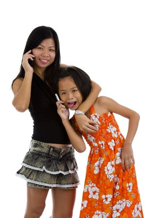 mother and daughter on the phone having fun, isolated on white background photo