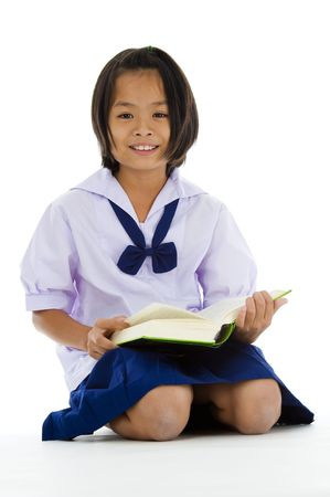 uniform skirt: cute asian schoolgirl with book, isolated on white background