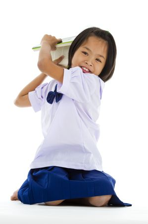uniform skirt: cute girl throwing a book, isolated on white background Stock Photo