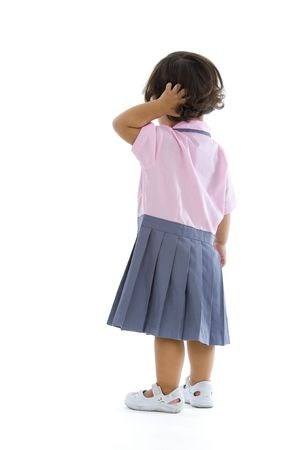 backside: 2 years old girl with school uniform, isolated on white background Stock Photo