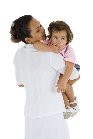 nanny: woman who could be her mother, nurse, nanny or teacher holding a sweet 2 girl, isolated on white background