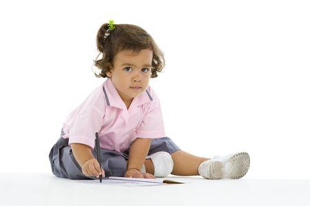 cute 2 years old girl writing something, isolated on white background Stock Photo - 7066921