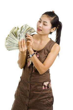 pretty woman holding lots of 100 dollar bills in her hand, isolated on white background Stock Photo - 7138748