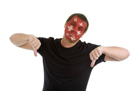 man with swiss flag painted on his face showing two thumbs down, isolated on white background photo