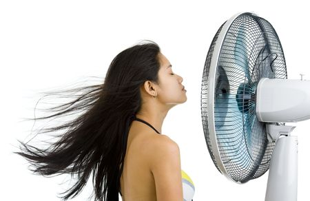 woman blowing: pretty woman enjoying fan blowing from front right side, isolated on white background