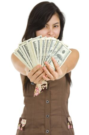 pretty woman holding lots of 100 dollar bills in her hand, isolated on white background with a shallow depth of field, focussed on the dollar bills Stock Photo - 7396663