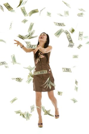 person falling: pretty woman throwing 100 dollar bills, isolated on white background