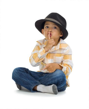 noiseless: cute boy with finger on his lips, isolated on white background Stock Photo