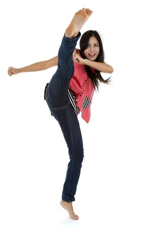 kung: pretty woman kicking with her foot high up, isolated on white background  Stock Photo