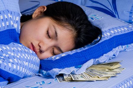 matress: woman sleeping with money under her pillow