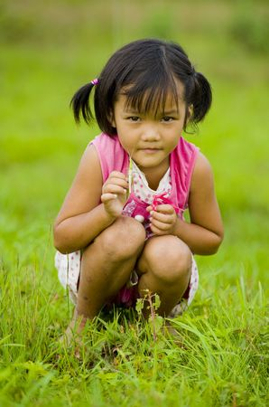 cowering: cute girl holding a grasshopper in her hand