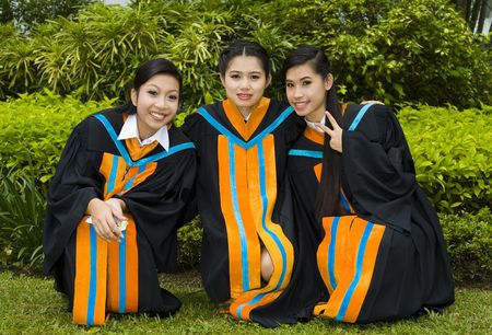 proud and happy asian students posing on their graduation day photo