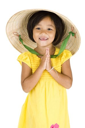 greet: cute girl with vietnamese hat and typical asian welcome expression, isolated on white background