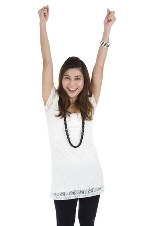 woman cheering with her fists in the air, isolated on white background Stock Photo - 7871896