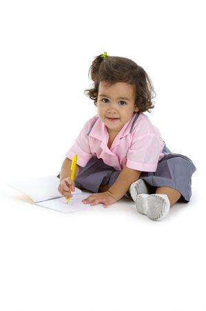 cute 2 years old girl writing something, isolated on white background Stock Photo - 7955026