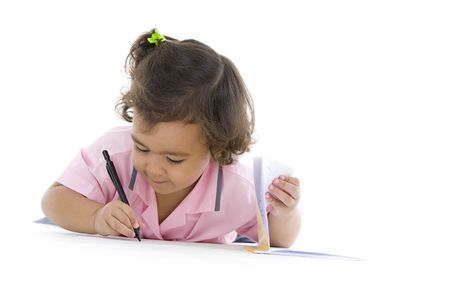 kids writing: cute 2 years old girl writing something, isolated on white background Stock Photo