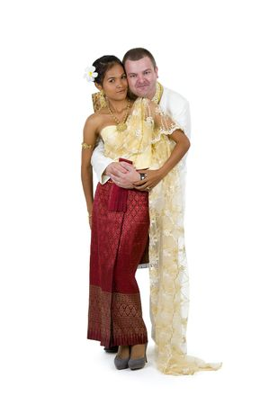 happily married couple in traditional thai wedding clothes posing on white background photo